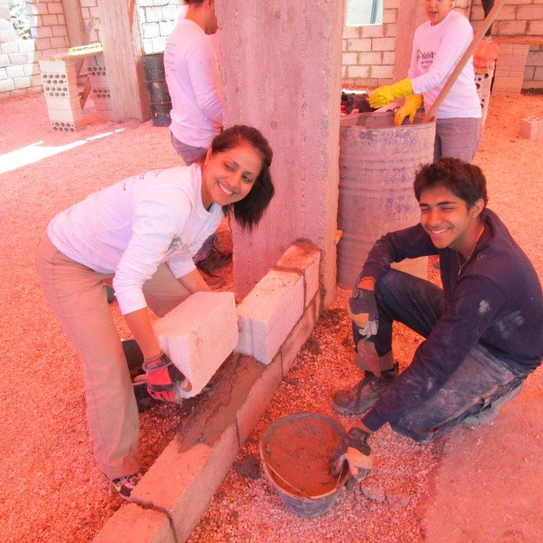 Suchir, age 16, and his mother Aparna participate on a Habitat for Humanity build in Jordan.
